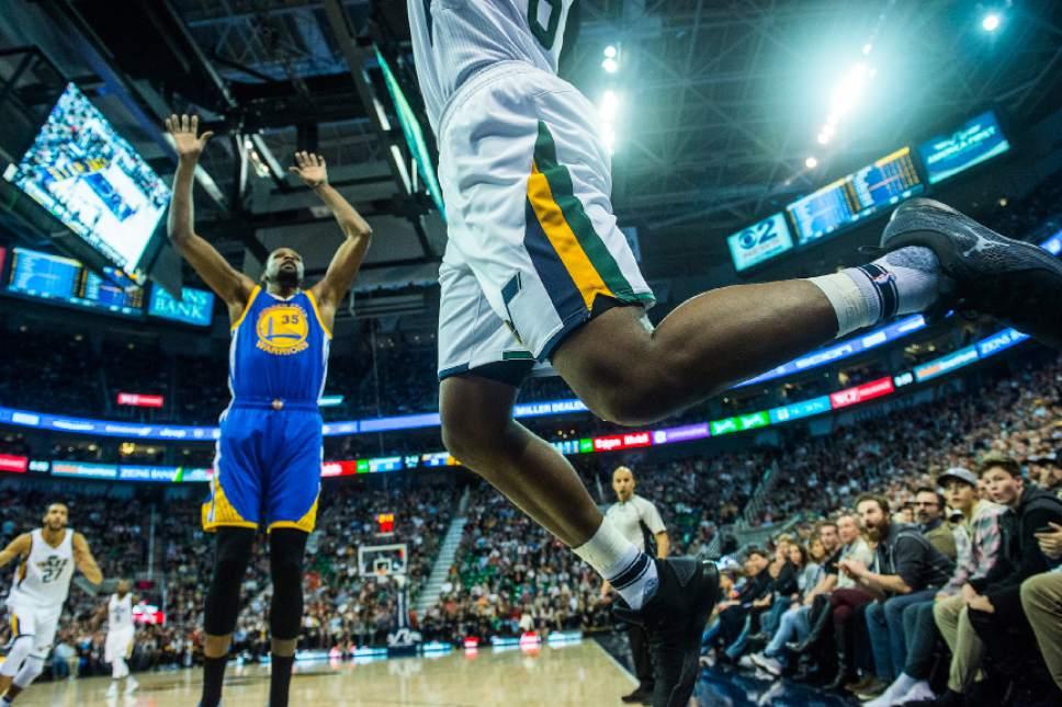 Chris Detrick  |  The Salt Lake Tribune Utah Jazz forward Joe Johnson (6) passes the ball around Golden State Warriors forward Kevin Durant (35) during the game at Vivint Smart Home Arena Thursday December 8, 2016.