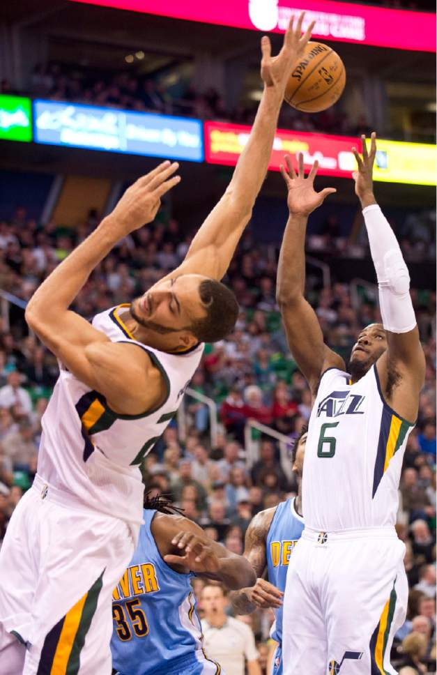 Lennie Mahler  |  The Salt Lake Tribune  Utah Jazz center Rudy Gobert falls as Joe Johnson pulls in a rebound in the first half of a game at Vivint Smart Home Arena in Salt Lake City, Saturday, Dec. 3, 2016.
