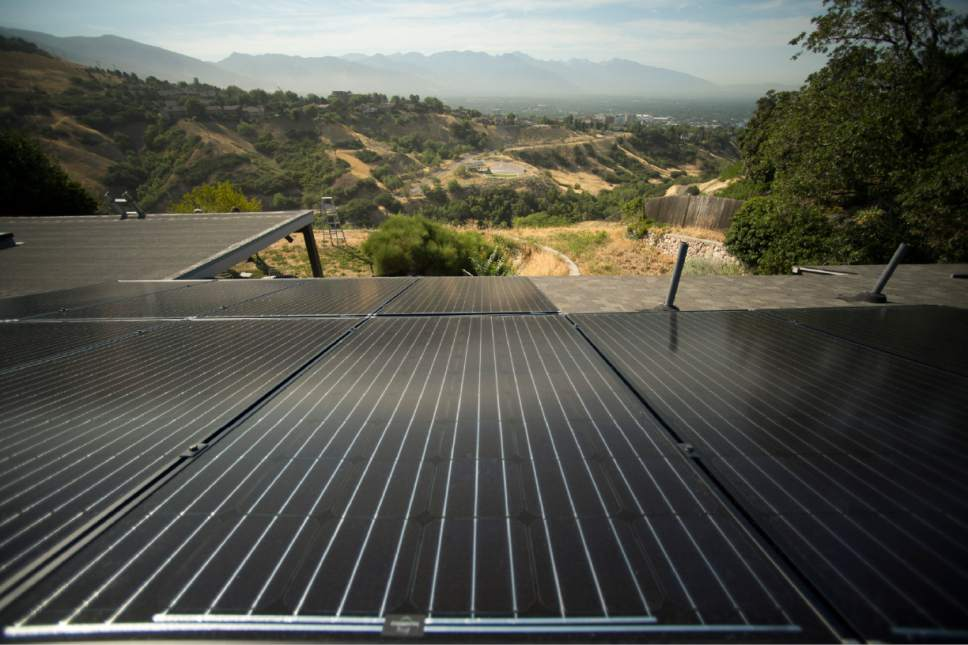 Rick Egan  |  The Salt Lake Tribune  Stan Holmes installed solar panels on his roof, Rocky Mountain power wants net-metered customers like Holmes, who have invested thousands in solar arrays to pay a monthly fee, Friday, July 25, 2014