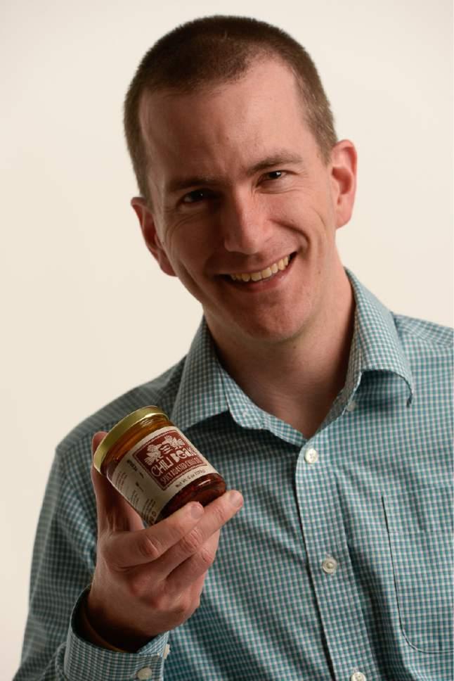 Francisco Kjolseth | The Salt Lake Tribune Jason MClure, co-founder of Chili Beak Spicy Roasted Chili Oil.