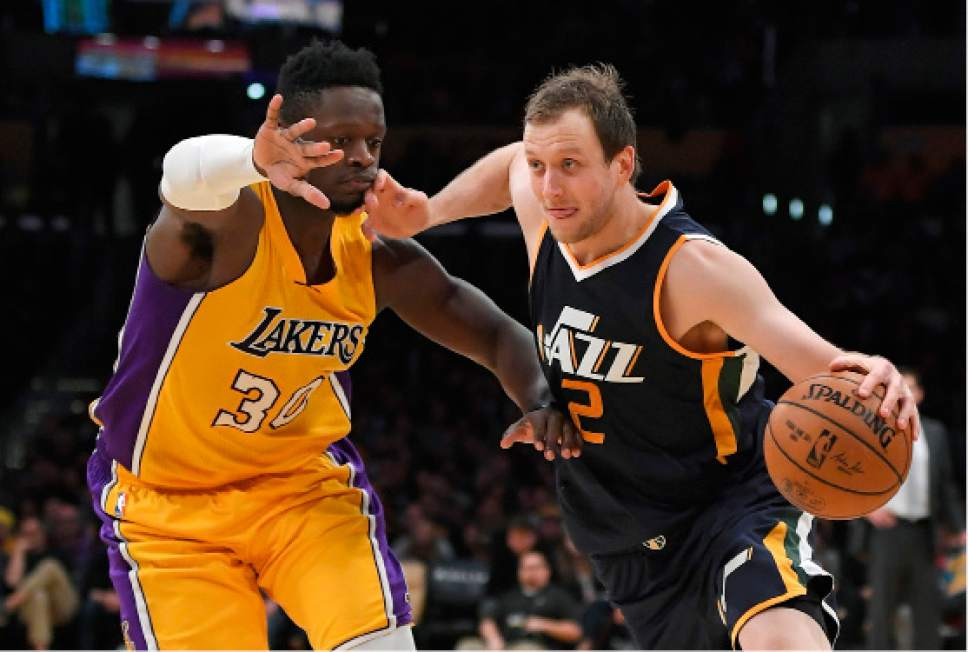 3e809549709 Utah Jazz forward Joe Ingles, right, of Australia, drives pas Los Angeles  Lakers