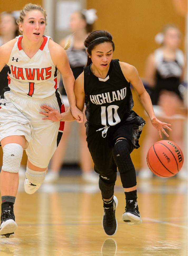 Trent Nelson  |  The Salt Lake Tribune Highland's Marlee Machon (10) dribbles the ball, defended by Alta's Mariah Martin as Alta faces Highland in a quarterfinals game at the 4A High School Girls Basketball Tournament at Salt Lake Community College in Taylorsville, Wednesday February 24, 2016.