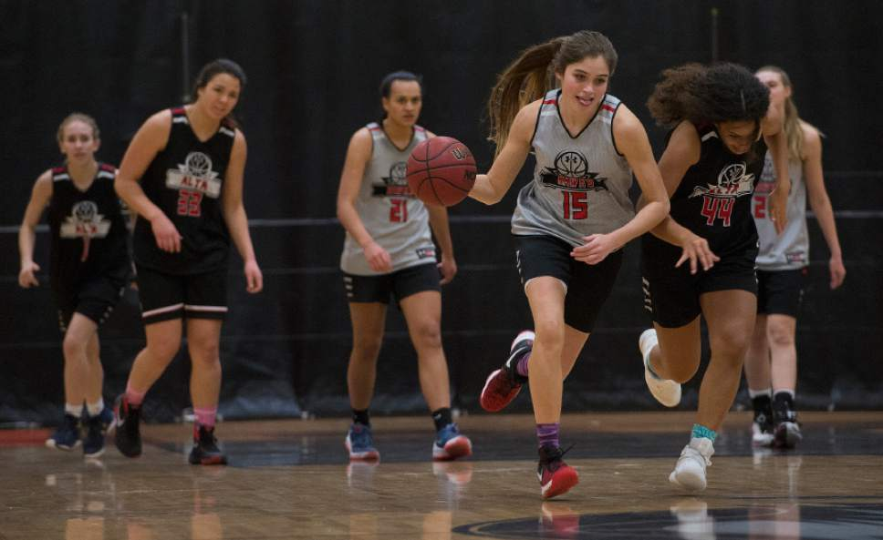 "Leah Hogsten  |  The Salt Lake Tribune Kemery Martin runs down the court after stealing the ball from her teammates Thursday, February 2, 2017. ""We're always on the same side of understanding with each other,"" said sisters Mariah, 17, and Kemery Martin, 16, two of the  leaders on the Alta High School girls' basketball team,Thursday, February 2, 2017."