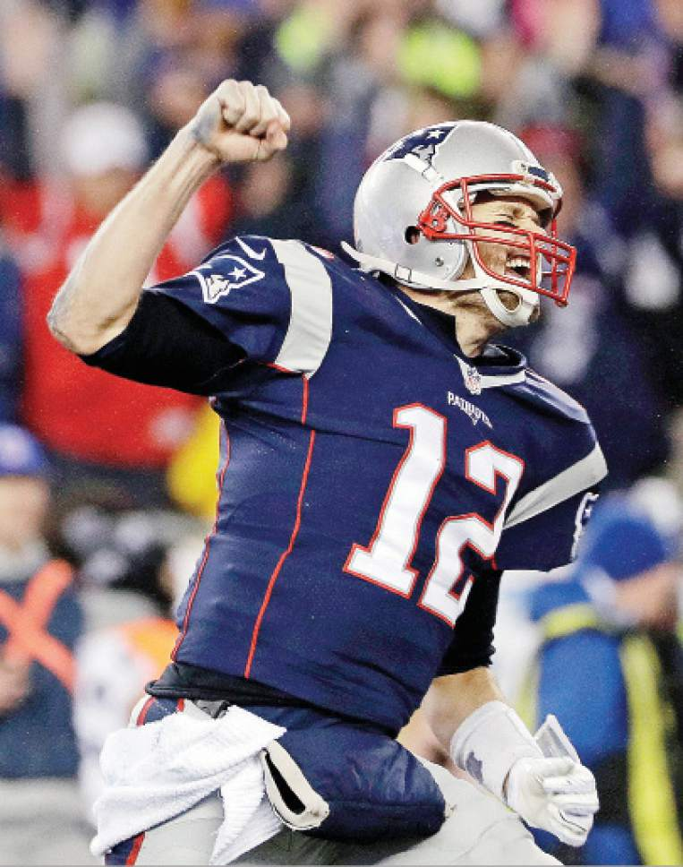 New England Patriots quarterback Tom Brady reacts after throwing a touchdown  pass to Julian Edelman during c06937058