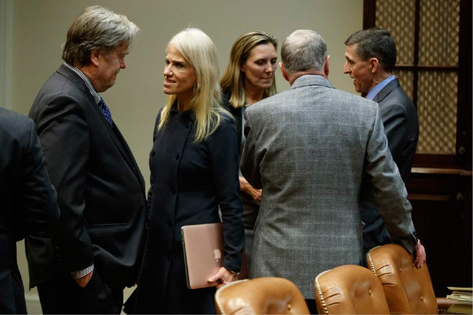 White House Chief Strategist Steve Bannon, left, talks with Senior Adviser Kellyanne Conway in the Roosevelt Room of the White House in Washington, Tuesday, Jan. 31, 2017, before a meeting with President Donald Trump on cyber security. From left are, Bannon, Conway, Andrea Thompson, National Security Adviser to Vice President Mike Pence, Ret. Gen. Keith Kellogg, and National Security Adviser Mike Flynn. (AP Photo/Evan Vucci)