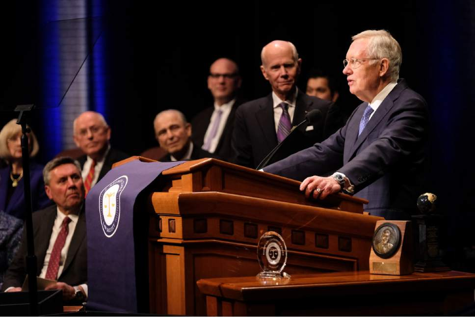 Courtesy     LDS Newsroom  Retired Senator Harry Reid was given the J. Reuben Clark Law Society's Distinguished Public Service Award January 20, 2017, at the organization's annual fireside in the Conference Center.