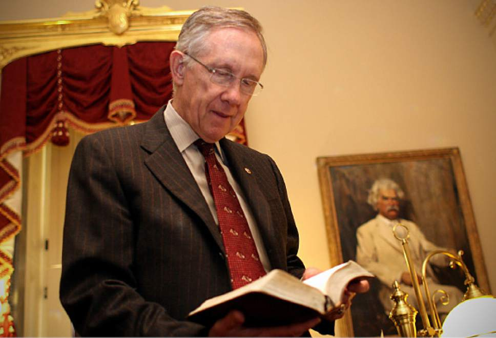 Cobb Condie     Tribune File Photo  Senate Majority Leader Harry Reid (D-Nev.) takes time in his office in the Capitol to show the Mormon scriptures he keeps in his desk.  Sen. Reid keeps extra copies of the Book of Mormon in the same same drawer to give away to guests that visit his office.