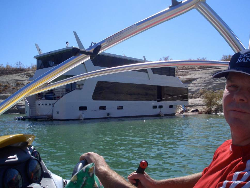 |  Photos obtained by the Salt Lake Tribune  In 2010, then Chief Deputy Attorney General John Swallow took a free family vacation on St. George businessman Jeremy Johnson's houseboat on Lake Powell. Photos of the trip are part of the evidence against Swallow in his public corruption trial slated to begin on Tuesday.