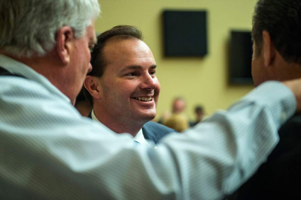 Chris Detrick     The Salt Lake Tribune Sen. Mike Lee, R-Utah, talks with constituents from Utah during a reception in the Oversight Committee Room in the Rayburn House Office Building Thursday January 19, 2017.