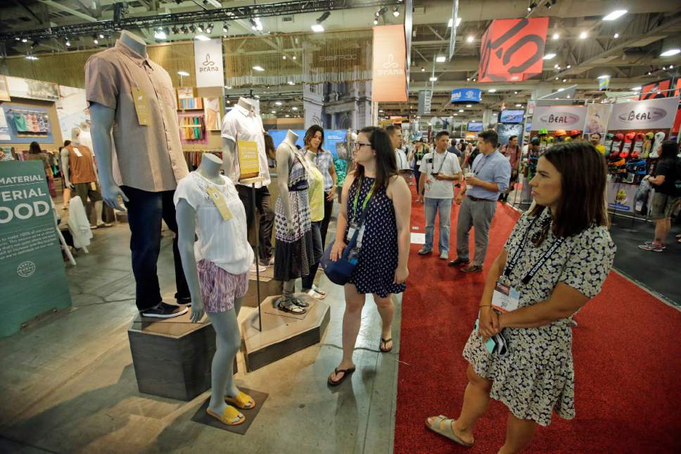 People walk past the Prana exhibit during the Outdoor Retailer show Thursday, Aug. 4, 2016, in Salt Lake City. A wide array of clothing, gear and equipment specifically designed for women outdoor adventurers is on display at the summer version of the world's largest outdoor gear show for retailers that brings thousands of  people to Salt Lake City. (AP Photo/Rick Bowmer)