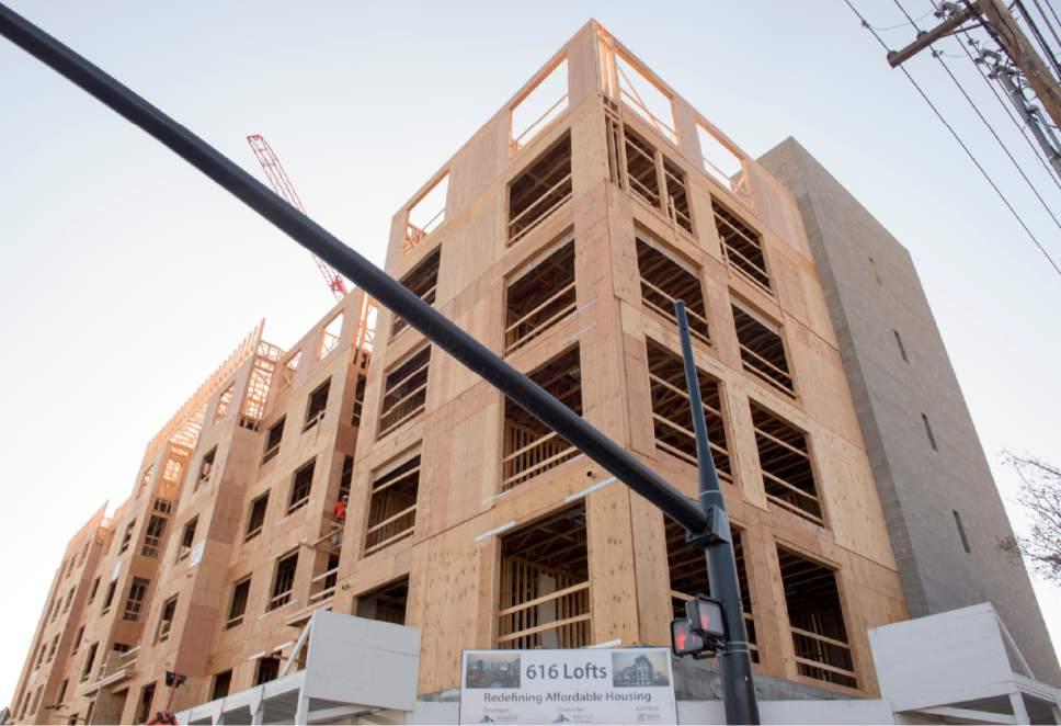 Rick Egan      Tribune file photo  The 616 Lofts housing development under construction at 600 South State in Salt Lake City, Friday, November 11, 2016.