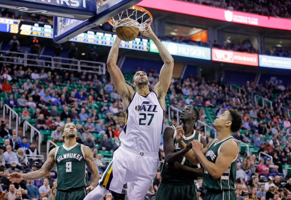 Utah Jazz center Rudy Gobert (27) dunks the ball as Milwaukee Bucks' Michael Beasley (9), Thon Maker, second from right, and Malcolm Brogdon, right, look on in the second half during an NBA basketball game, Wednesday, Feb. 1, 2017, in Salt Lake City. The Jazz won 104-88. (AP Photo/Rick Bowmer)