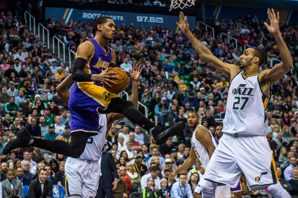 Chris Detrick  |  The Salt Lake Tribune Los Angeles Lakers guard Jordan Clarkson (6) passes around Utah Jazz center Rudy Gobert (27) during the game at Vivint Smart Home Arena Thursday January 26, 2017.