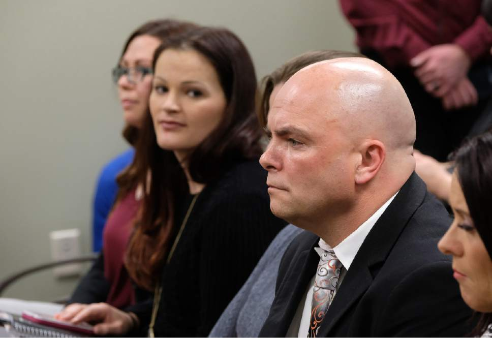 "Francisco Kjolseth | The Salt Lake Tribune Polygamist Joe Darger, right, attends a hearing for HB99, a bill amending Utah's bigamy statute, as it goes back to the House Judiciary Committee for another hearing at the Utah Capitol on Tuesday, Feb. 7, 2017. At left are Luanne Cooper, a former member of the Polygamist Kingston clan and Jessica Christensen of the show ""Escaping Polygamy."""