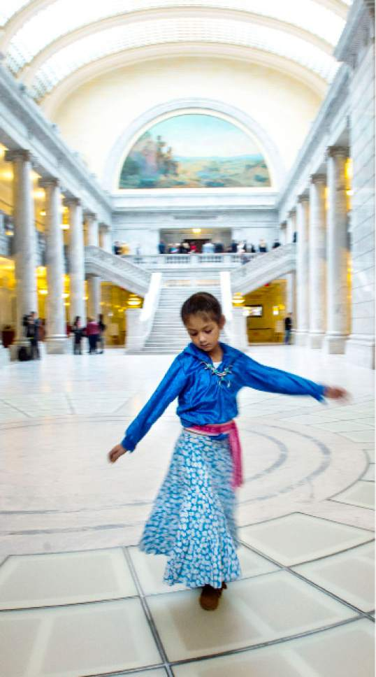 Steve Griffin  |  The Salt Lake Tribune   Aliya Cruz, a first grader at Larsen Elementary School in Spanish Fork, Utah spins around in the Capitol Rotunda as she attends Native American Caucus Day at the legislature in Salt Lake City Monday February 6, 2017. Cruz, who is from the Hualapai Tribe, and other students with the Nebo School District Indian Education (Title Vl) program  came to the Capitol to meet legislators and see how bills work their way through he legislative process.