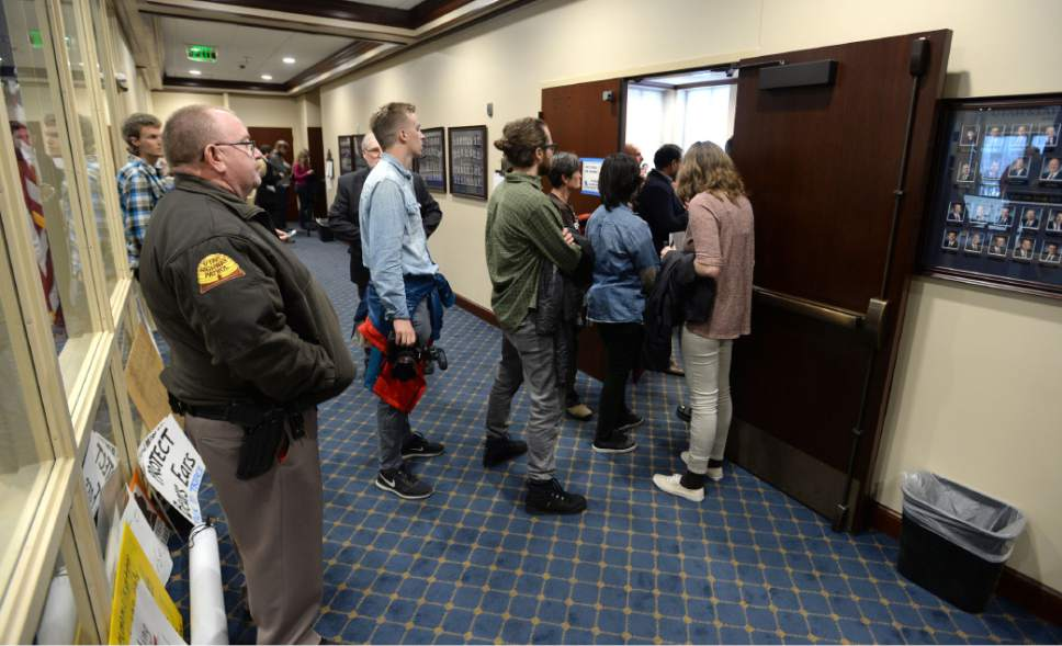 Steve Griffin  |  The Salt Lake Tribune   Overflow crowds look in from the hallway as citizens speak agains HRC12, a resolution that urges the President of the United States to rescind the Bears Ears National Monument designation, during the Senate Natural Resources, Agriculture, and Environment Committee meeting at the State Capitol in Salt Lake City Thursday February 2, 2017.