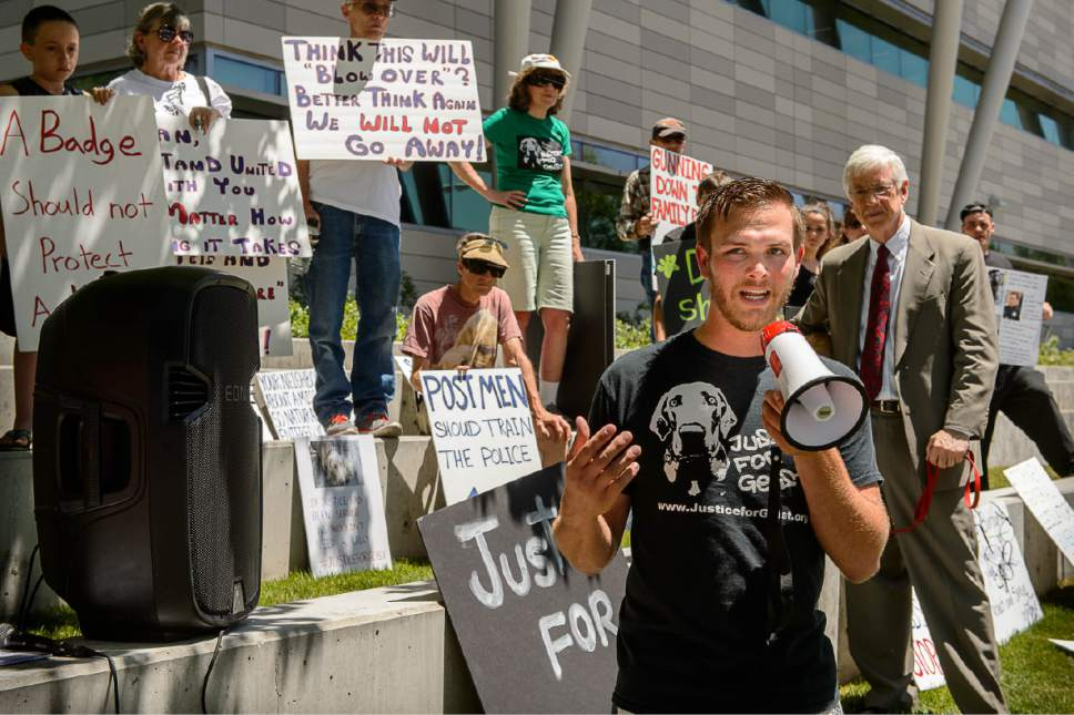 Trent Nelson  |  The Salt Lake Tribune Sean Kendall speaks as twenty people and a few pets ralliy outside Salt Lake City police headquarters on Thursday who sympathize with dog owner Kendall and are calling for accountability from the department and the officer who fatally shot Kendall's Weimaraner one year ago.