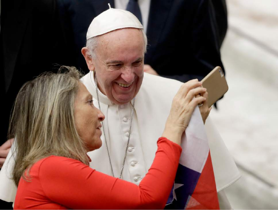 A faithful takes a selfie of herself with Pope Francis during his weekly general audience in Paul VI Hall, at the Vatican, Wednesday, Feb. 8, 2017. (AP Photo/Andrew Medichini)