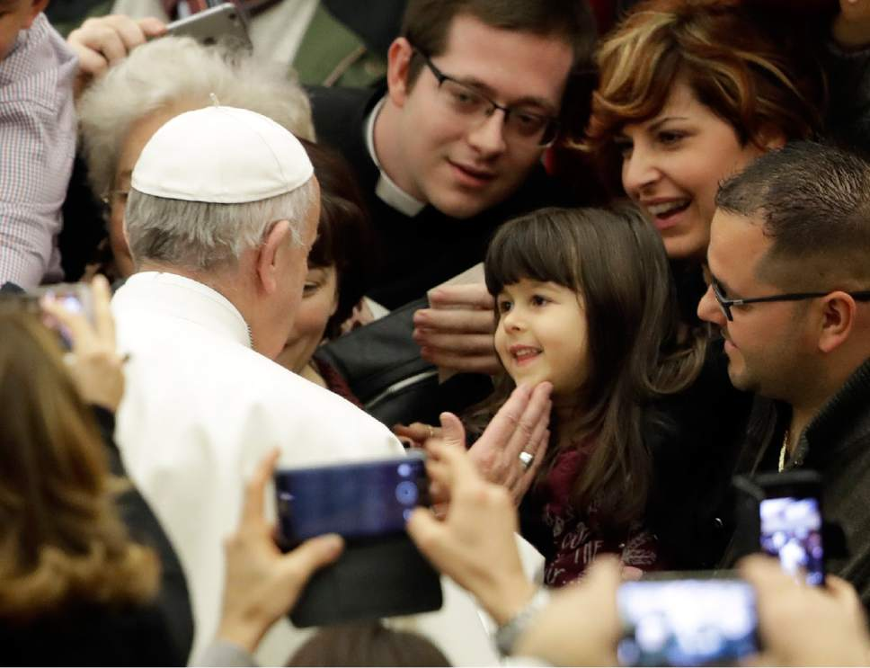 Pope Francis caresses a child during his weekly general audience in Paul VI Hall, at the Vatican, Wednesday, Feb. 8, 2017. (AP Photo/Andrew Medichini)