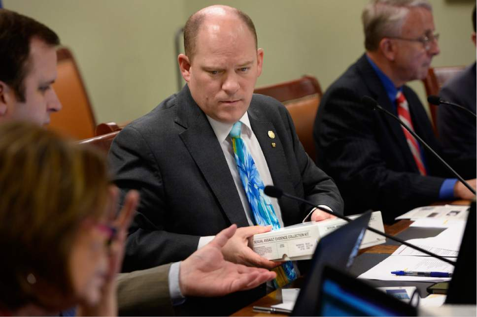 Scott Sommerdorf   |  The Salt Lake Tribune   Senator Daniel Thatcher, R-West Valley City, passes on a rape kit that was shown to legislators as Rep. Angela Romero, D-Salt Lake, presented her bill, HB200 – Sexual Assault Kit Processing Amendments – during a House Revenue and Taxations committee meeting at the Utah State Capitol complex on Wednesday.