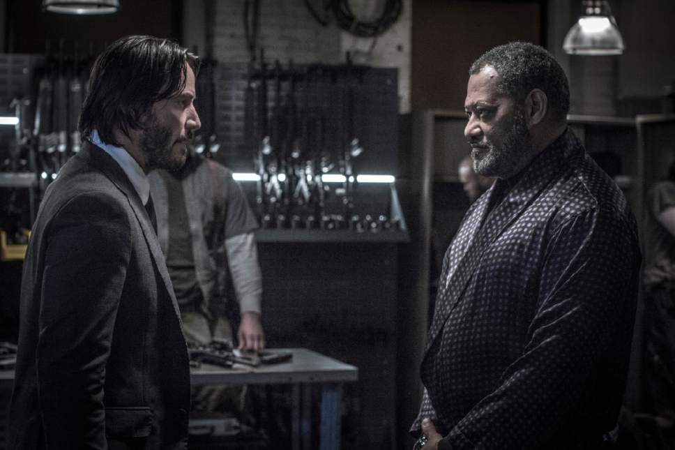 """This image released by Lionsgate shows Keanu Reeves, left, and Laurence Fishburne in a scene from, """"John Wick: Chapter 2."""" (Niko Tavernise/Lionsgate via AP)"""