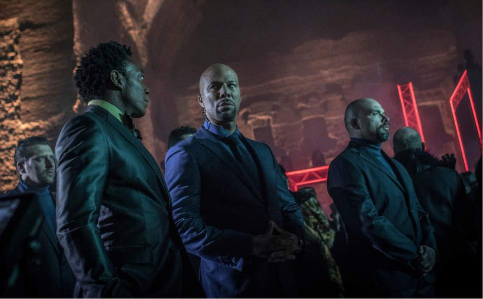 """This image released by Lionsgate shows Common, center, in a scene from, """"John Wick: Chapter 2."""" (Niko Tavernise/Lionsgate via AP)"""