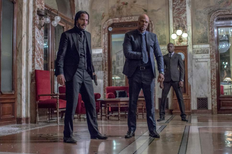 """This image released by Lionsgate shows Keanu Reeves, left, and Common in a scene from, """"John Wick: Chapter 2."""" (Niko Tavernise/Lionsgate via AP)"""