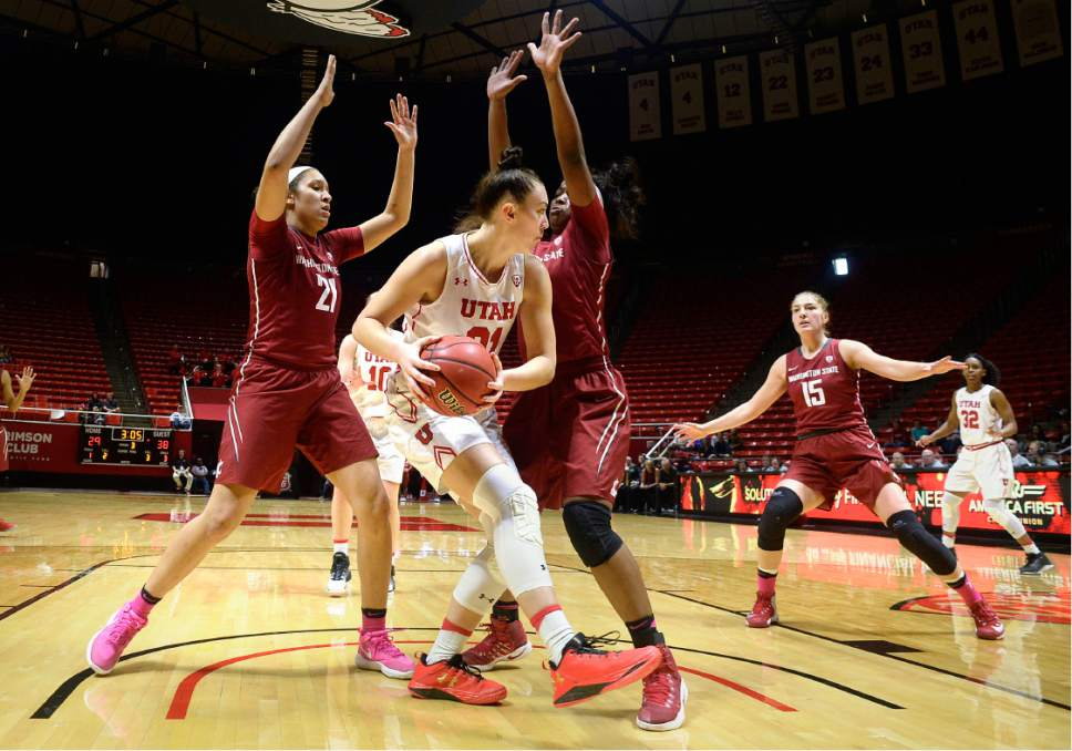 Scott Sommerdorf   |  The Salt Lake Tribune   Utah Utes forward Wendy Anae (21) looks to pass after being boxed in under the hoop during second half play. Washington State beat Utah 61-55, Sunday, February 5, 2017.
