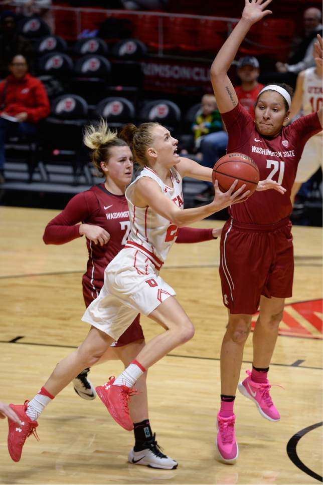 Scott Sommerdorf   |  The Salt Lake Tribune   Utah Utes guard/forward Tilar Clark (24) drives for a shot that was blocked by Washington State Cougars forward Nike McClure (21) during first half play. Washington State beat Utah 61-55, Sunday, February 5, 2017.