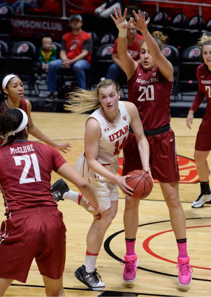 Scott Sommerdorf   |  The Salt Lake Tribune   Utah Utes guard Paige Crozon (14) spins to try to find a team mate to pass to after her drive was stymied by the Cougar defense. Washington State beat Utah 61-55, Sunday, February 5, 2017.