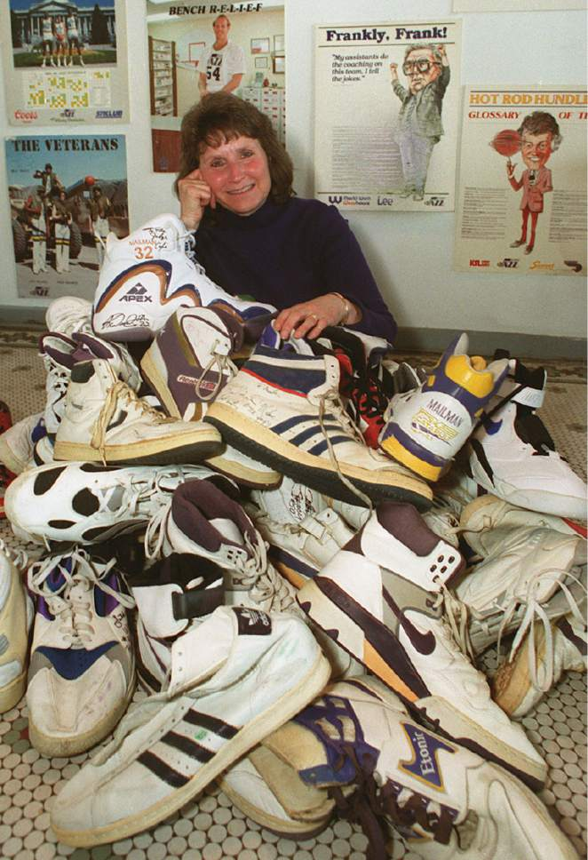 Rick Egan  |  Tribune file photo  Carol Couch poses with her collection of NBA player's shows at Judge Cafe with tons basketball shoes in this 1999 photo.