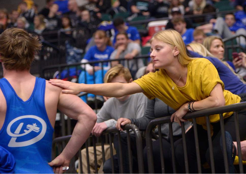 Leah Hogsten  |  The Salt Lake Tribune Hannah Nyberg reaches out to console her brother, Hobbs Nyberg, a wrestler for Dixie High School who lost his 160lb. match at the 3A State Wrestling Championships, February 10, 2017 at Utah Valley University.