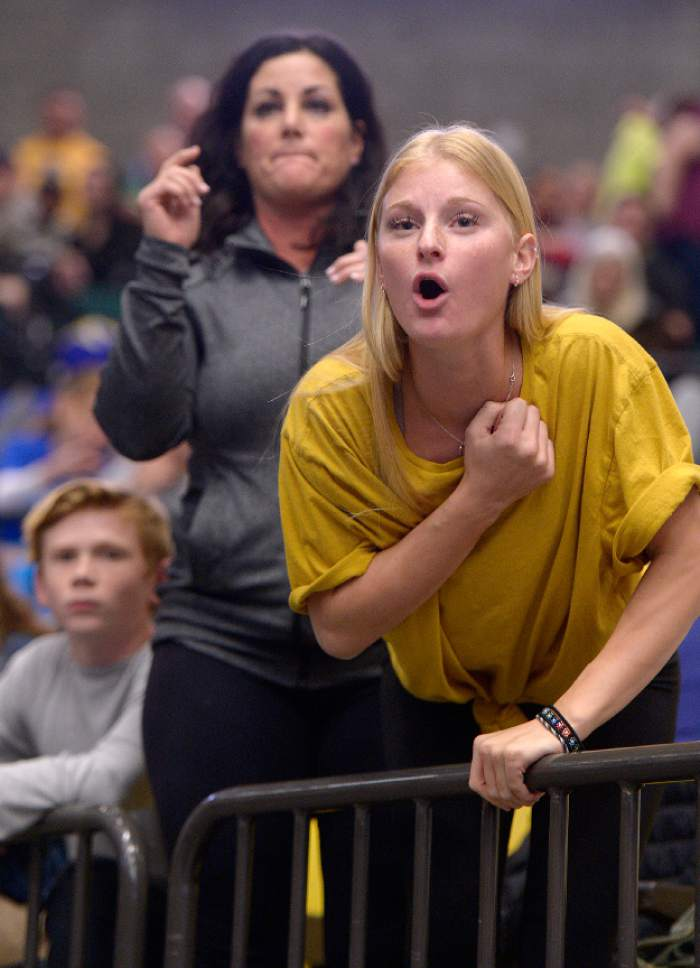 Leah Hogsten  |  The Salt Lake Tribune l-r Dixie High School wrestler Hobbs Nyberg's brother Jesee, mother Jamee and sister Hannah cheer during his 160lb. match at the State Wrestling Championships, February 10, 2017 at Utah Valley University.