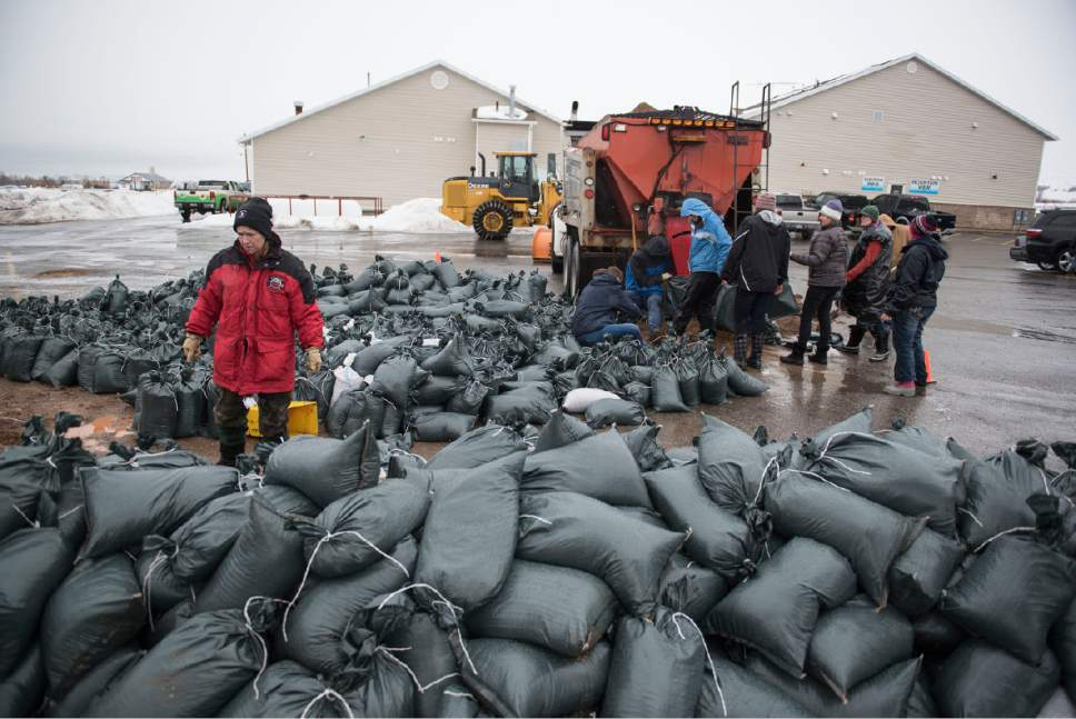Lennie Mahler  |  The Salt Lake Tribune  Volunteers fill bags with sand to block flooding in Garden City, Utah, Friday, Feb. 10, 2017.
