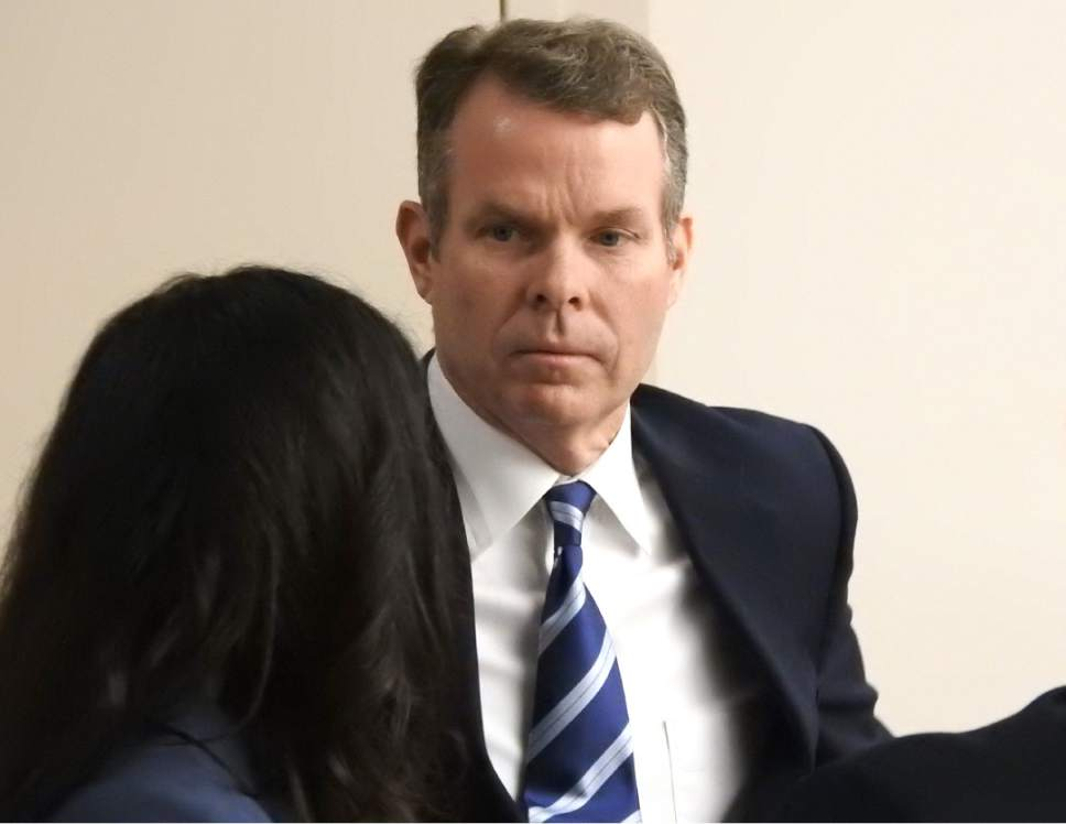 Rick Egan  |  The Salt Lake Tribune  John Swallow talks to Cara Tangaro from his defense team, during a recess in  his trial in Judge Elizabeth Hruby-Mills courtroom in Salt Lake City, Thursday, February 9, 2017.