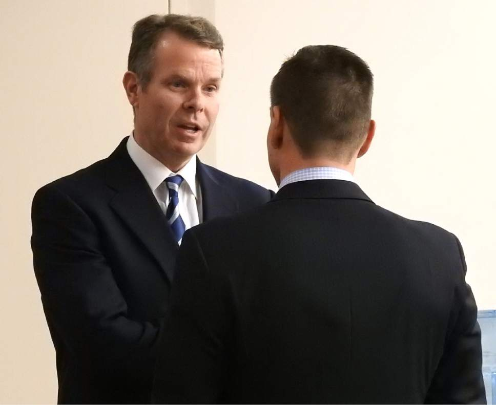 Rick Egan  |  The Salt Lake Tribune  John Swallow talks with Brad Anderson from his defense team, during a recess in  his trial in Judge Elizabeth Hruby-Mills courtroom in Salt Lake City, Thursday, February 9, 2017.