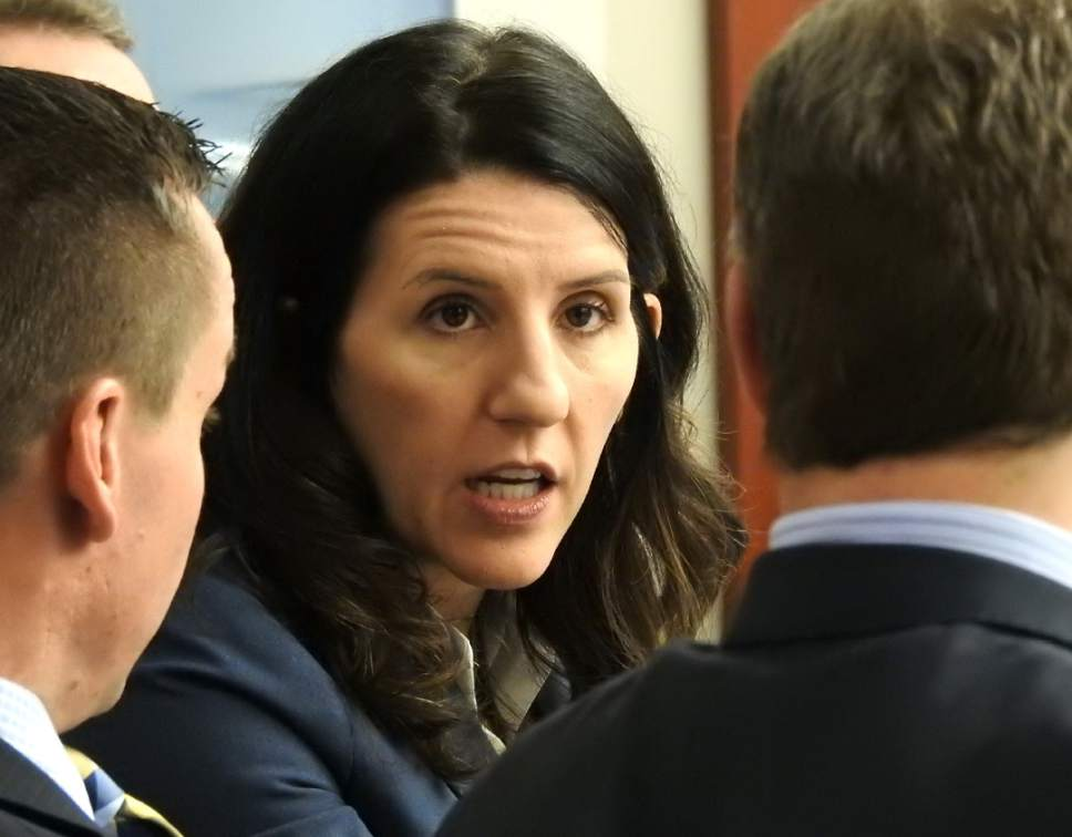 Rick Egan  |  The Salt Lake Tribune  Cara Tangaro, discusses an issue with Brad Anderson and Scott Williams, members of John Swallow's defense team, in Judge Elizabeth Hruby-Mills courtroom in Salt Lake City, Thursday, February 9, 2017.
