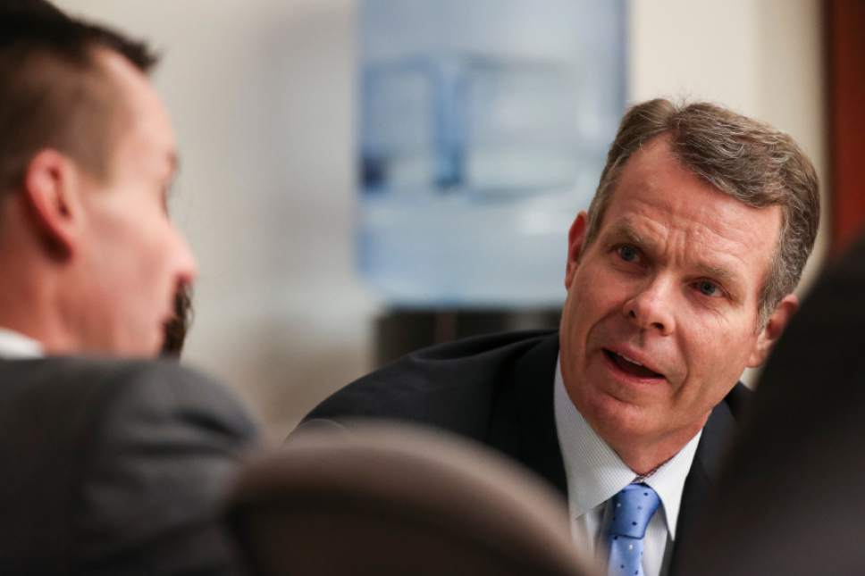 John Swallow sits with his defense team during the fourth day of his public corruption trial at the Matheson Courthouse in Salt Lake City on Friday, Feb. 10, 2017.