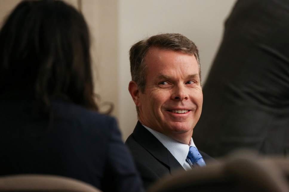 John Swallow talks to his defense attorney Cara Tangaro, left, before the start of the fourth day of Swallow's public corruption trial at the Matheson Courthouse in Salt Lake City on Friday, Feb. 10, 2017.