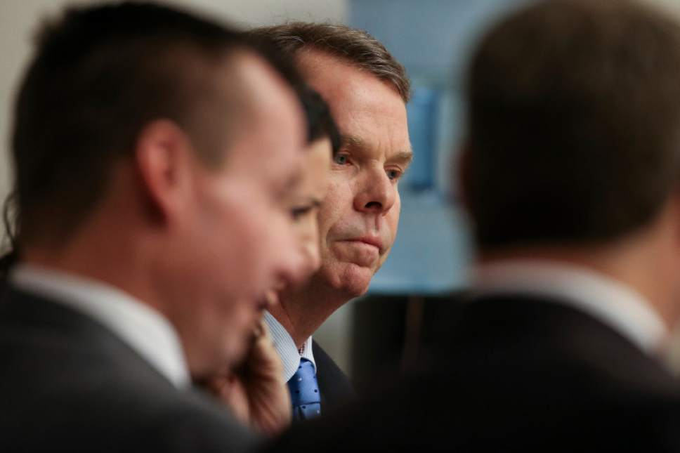John Swallow sits with his defense team on the fourth day of his public corruption trial at the Matheson Courthouse in Salt Lake City on Friday, Feb. 10, 2017.