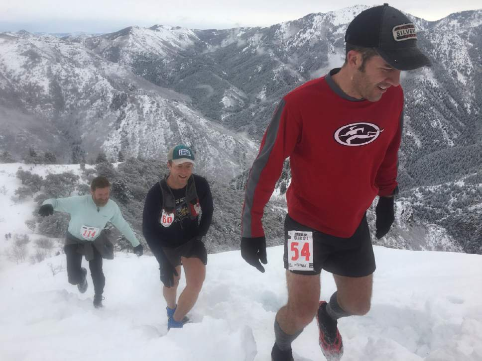 Brian Maffly  |  The Salt Lake Tribune Cody Draper, right, Shane Hughes, middle, and Matt Gunn, left, push to the summit of Grandeur Peak on Saturday for the annual Running Up For Air 24-hour endurance challenge. The event raises money for Breathe Utah and awareness about the Wasatch Front's poor air quality. The 125-participant race is staged out of Mill Creek Canyon's Church Fork picnic area, where runners do repeated 5.8-mile trips up and down the peak overlooking Salt Lake City.