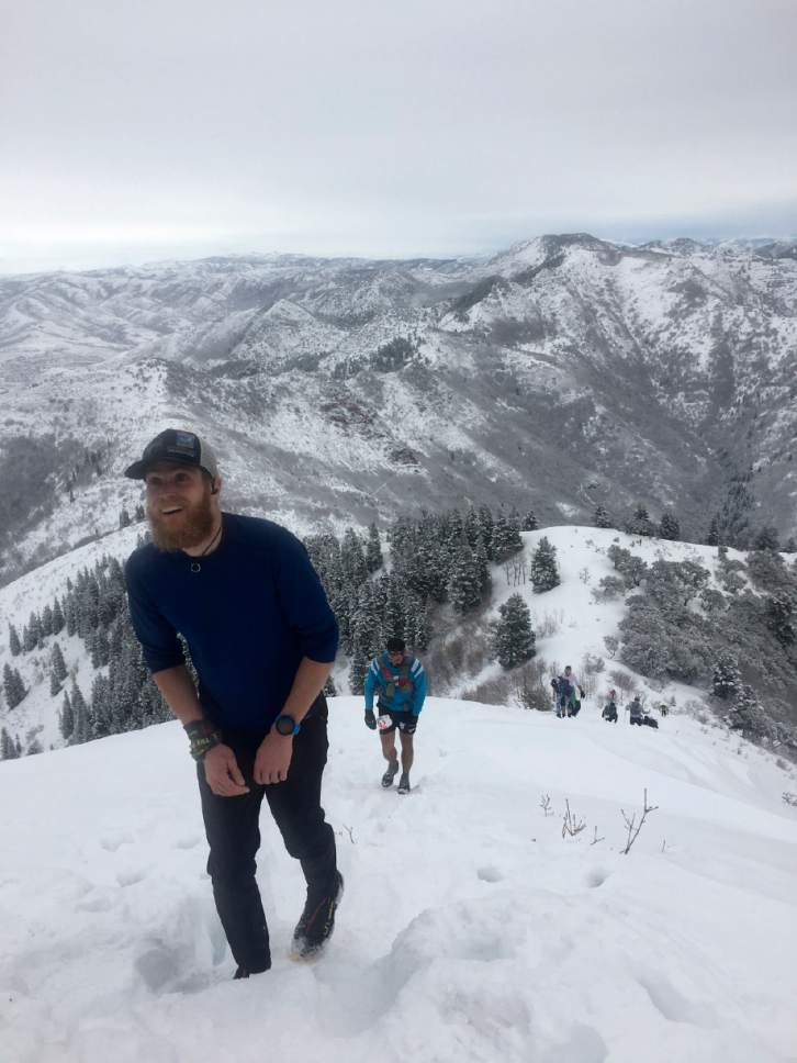 Brian Maffly     The Salt Lake Tribune  Luke Nelson pushes to the summit of Grandeur Peak on Saturday for the annual Running Up For Air 24-hour endurance challenge. The event raises money for Breathe Utah and awareness about the Wasatch Front's poor air quality. The 125-participant race is staged out of Mill Creek Canyon's Church Fork picnic area, where runners do repeated 5.8-mile trips up and down the peak overlooking Salt Lake City.
