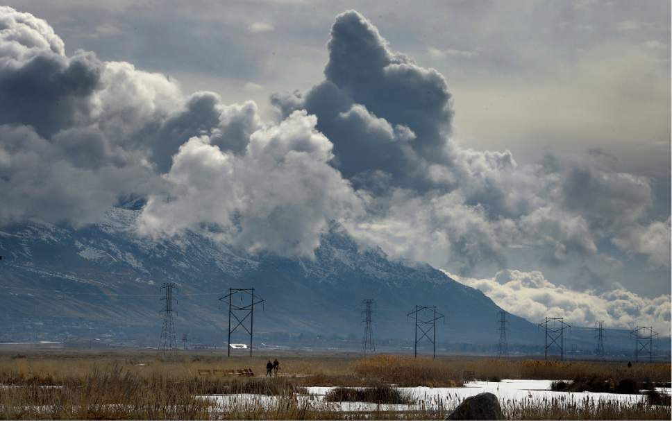 Scott Sommerdorf | The Salt Lake Tribune Visitors to the Bear River Migratory Bird Refuge near Brigham City, walk along a pond, Saturday, February 11, 2017