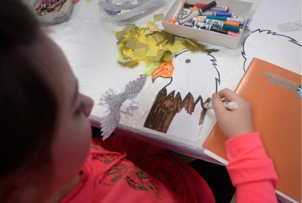 Scott Sommerdorf | The Salt Lake Tribune Aleksia Nielsen finishes her drawing of an eagle during an art activity at the Bear River Migratory Bird Refuge near Brigham City, Saturday, February 11, 2017