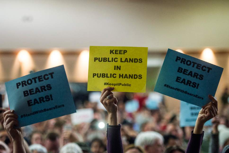 Chris Detrick  |  The Salt Lake Tribune Members of the audience hold up signs as U.S. Rep. Jason Chaffetz, R-Utah, speaks during the town-hall meeting in Brighton High School Thursday February 9, 2017.