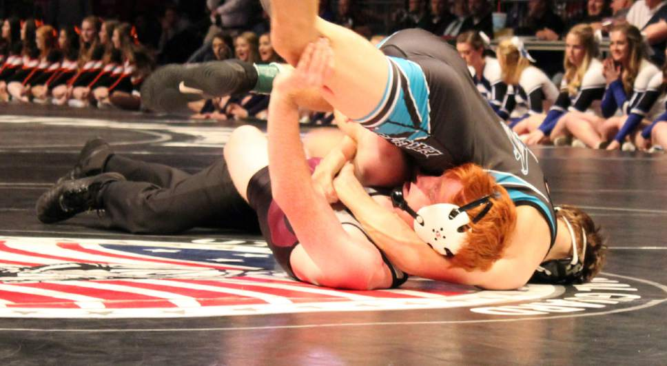 Beky Beaton  |  For The Tribune  Canyon View's Brady Lowry pins Pine View's Ben Worlton to win the Class 3A state title in the 132-pound division Saturday at the UCCU Center.