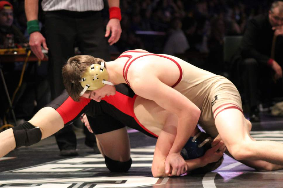 Beky Beaton  |  For The Tribune  Juab's Jayce Lind tries to work his way around Hurricane's Caleb Armstrong in their 126-pound state title match at the Class 3A state meet Saturday at the UCCU Center. Lind won the title by 5-2 decision.