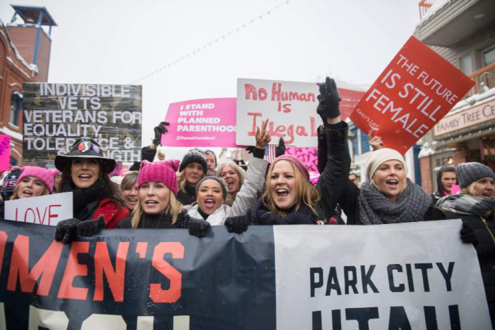 "Actresses Chelsea Handler and Charlize Theron participate in the ""Women's March On Main"" during the 2017 Sundance Film Festival on Saturday, Jan. 21, 2017, in Park City, Utah. (Photo by Arthur Mola/Invision/AP)"