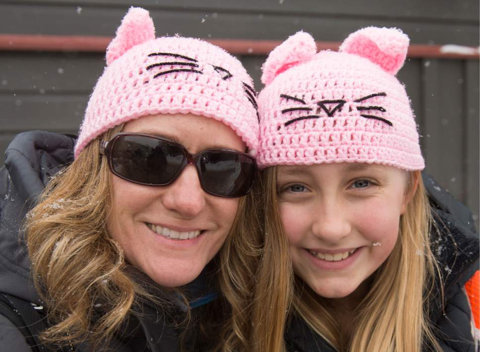 "Leah Hogsten  |  The Salt Lake Tribune l-r Stacey Collett and her daughter Olivia, 12 said they missed the march due to traffic and weather conditions Saturday, but they kept their ""solidarity"" hats on to show support for the march on Washington. In conjunction with the Women's March on Washington, women and men participated in the Women's March on Main in Park City, one of over 200 sister marches being planned in all 50 states and in 20 countries around the world for universal respect for social justice and human rights issues ranging from race, ethnicity, gender, religion, immigration and health care."