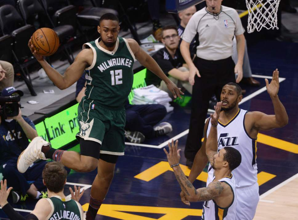 Steve Griffin / The Salt Lake Tribune  Milwaukee Bucks forward Jabari Parker (12) gets caught on the baseline as he tries to pass during NBA game against the Utah Jazz at Vivint Smart Home Arena in Salt Lake City Wednesday February 1, 2017.